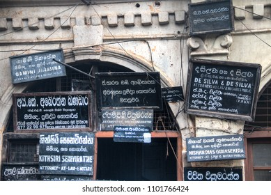 KANDY, SRI LANKA - DECEMBER 2017: Historic walls with lots of signs for attorneys and notaries in the center of Kandy in Sri Lanka