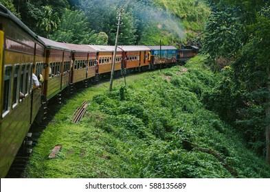 KANDY, SRI LANKA - December 25: Train to Kandy in Sri Lanka among tea plantations in the highlands of Sri Lanka. Taken on December 25, 2012, Kandy, Sri Lanka.