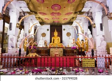 KANDY, SRI LANKA - DECEMBER 26, 2014: Shrine interior in the inner yard of Temple of the Buddha Tooth (Sri Dalada Maligawa)