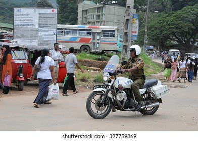 KANDY, SRI LANKA - DECEMBER 5, 2008: Police on the streets of Kandy. Kandy is a city in the Central part of Sri Lanka. Known as one of the sacred Buddhist cities.