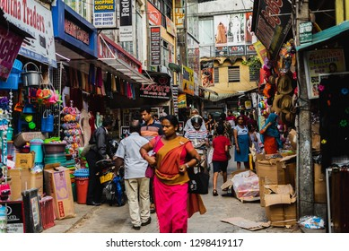 Kandy, Sri Lanka - January 12, 2019 - Busy street with a lot of people and cars, tuk-tuk taxis. he second largest city and the cultural capital of Sri Lanka.