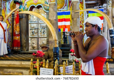 Kandy, Sri Lanka - July 18, 2011 : Dark skin man playing Horanewa in front of Tooth Sanctuary  in The Temple of Tooth Relic on the date of Perahera Festival in Kandy, Sri Lanka.
