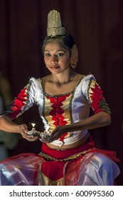 KANDY, SRI LANKA - JULY 28, 2012 : A female performer at the Esala Perahara theatre show in Kandy, Sri Lanka. The show depicts important sections of the great procession.