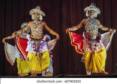 KANDY, SRI LANKA - JULY, 28, 2012 : Ves Dancers perform during the Esala Perahera festival in Kandy. The perahera is held to honour the sacred tooth relic of Buddha.