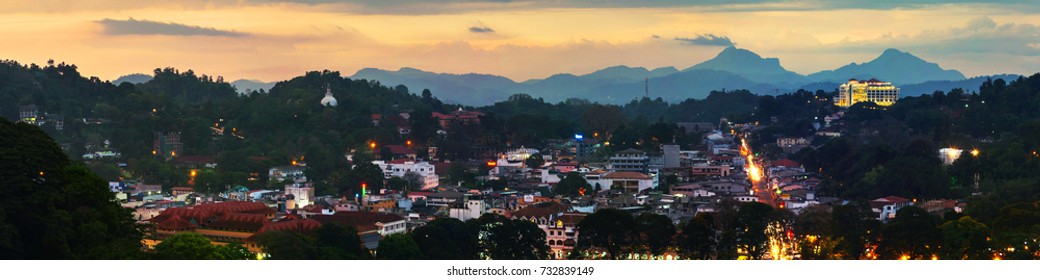 Kandy, Sri Lanka. Lake in Kandy. Sunset over the former capital of Sri Lanka. Panoramic view at night with car light trails