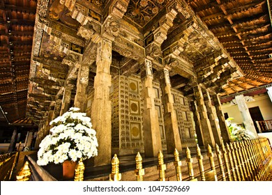 KANDY, SRI LANKA - March 2016: Carved stone building with pillars at ascred Temple of the Tooth in Kandy, Sri Lanka