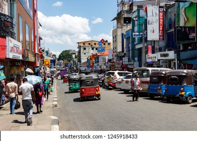 Kandy, Sri Lanka - March 27, 2018 - Busy street with a lot of people and cars, tuk-tuk taxis. Downtown Kandy. The second largest city and the cultural capital of Sri Lanka.
