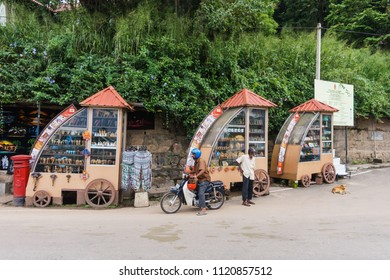 Kandy, Sri Lanka - November 11, 2017: The traditional souvenir and handicraft stalls, at the roadside of the hill near Kandy lake, waiting for tourists who come to see the view of the lake.