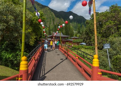 Kanehoe, Hawaii - August 6, 2017: Visitors tour the Byodo-In Temple during the Obon lantern Festival in Oahu, Hawaii