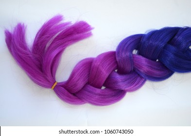 Kanekalon violet . Colored artificial strands of hair. Material for plaiting