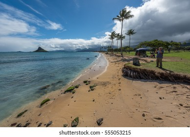 Kaneohe Bay, Hawaii - January 7, 2017: Mokolii, commonly known as Chinaman 's Hat, is a basalt islet in Kaneohe Bay, Hawaii.