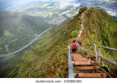 KANEOHE, HAWAII - MAR 2:  Hikers on the Stairway to Heaven trail overlooking the windward side of Oahu, Hawaii on March 2, 2019. The beautiful trail is illegal approached from Kaneohe side.