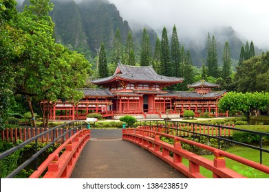 Kaneohe, HI USA August 2, 2014 A footbridge leads to the Byodo In Temple in in the Valley of the Temples in Kaneohe, Hawaii