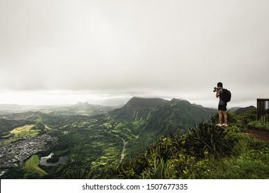 Kaneohe, Oahu - 25 AUGUST 2019: Guy takes photos at the top of the Stairway to Heaven (Haiku Stairs) hike. Oahu, Hawaii.