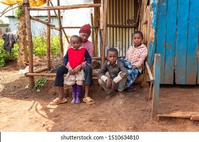 Kangaita village, Meru county, Kenya – June 15th, 2019: Impoverished children posing for portrait during meeting with British Jalia charity worker meeting Kenyan children who benefit from sponsorship.