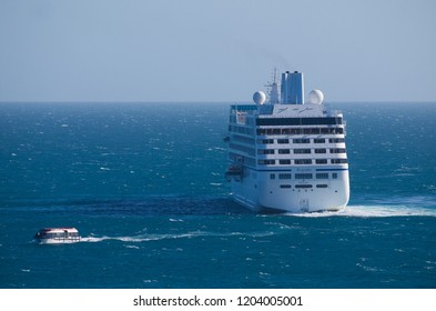 Kangaroo Island, Australia - January 16 2018: A tender passes by the Oceania Cruisers Regatta ship in the waters of Penneshaw.