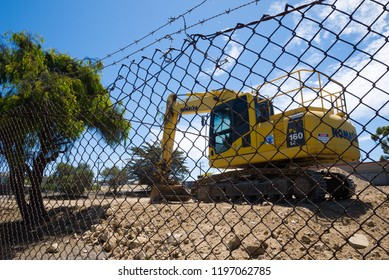 Kangaroo Island, Australia - January 24, 2018: An excavator parked on a section of vacant land in Kingscote on a bright, sunny afternoon.