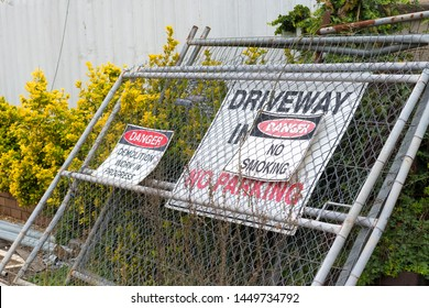 Kangaroo Valley, NSW, Australia-June 8, 2019: Construction and work in progress signs on wire fence gates