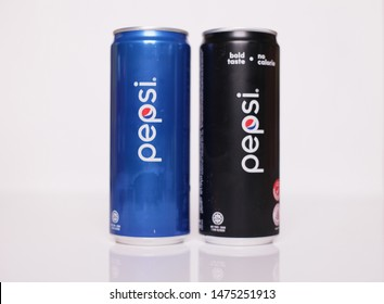 KANGAR,PERLIS,MALAYSIA, 10 AUGUST 2019: Pepsi drink in a can on ice isolated on white background. Pepsi is carbonated soft drink produced by PepsiCo. Pepsi was created and developed in 1893