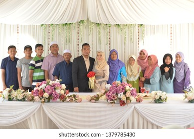 KANGAR,PERLIS,MALAYSIA - 4th March 2019 - Malaysian happy family portrait during wedding ceremony.Malay wedding ceremony full of culture and tradition