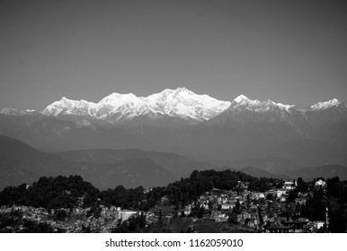 Kangchenjunga also Kanchenjunga is the third highest mountain in the world, lies partly in Nepal and partly in India. Elevation at 8586 meter. Black and White landscape photo is panoramic.