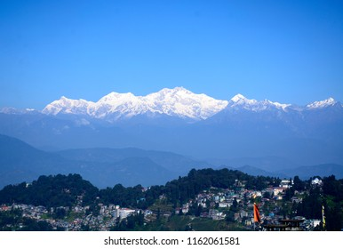 Kangchenjunga also Kanchenjunga is the third highest mountain in the world, lies partly in Nepal and partly in India. Elevation at 8586 meter. View from Darjeeling is scenic and beautiful.