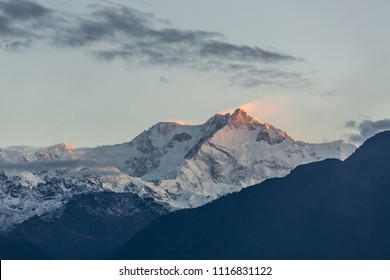 Kangchenjunga mountain at sunrise view from Pelling in Sikkim, India. Kangchenjunga is the third highest mountain in the world.