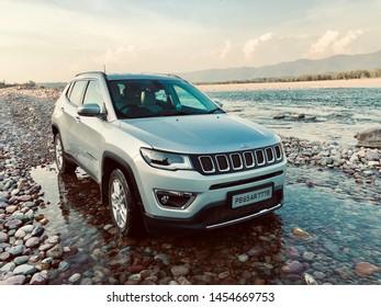 Kangra, Himachal Pradesh/India - Jun 2nd,2019: Jeep Compass Silver 4x4 crossing water banks.