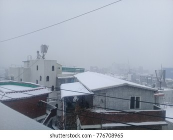 KANGWON, SOUTH KOREA - DECEMBER 10 2017: Chuncheon city in snowfall, houses roofs covered with snow