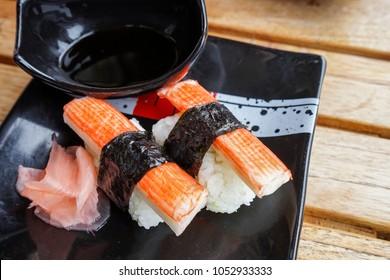 Kani Japanese sushi or crab stick sushi on a black plate