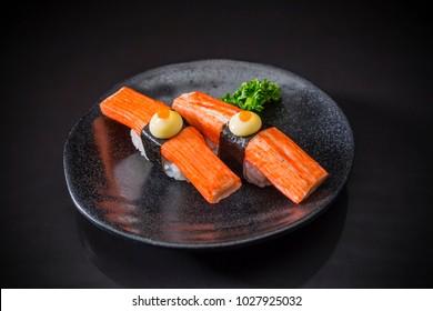 Kani Nigiri, Sushi Kani,  traditional Japanese food on ceramic dish, Japanese food style, Japanese food menu, sushi Kani, Crab stick sushi on black background, sushi bar Menu, selective focus