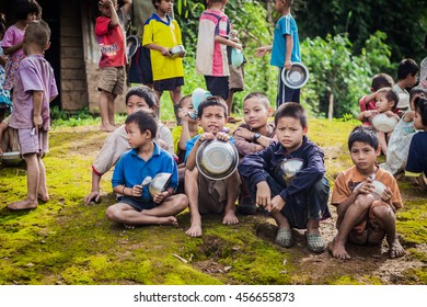 Kanjanaburi Province, Thailand-18 AUGUST 15: Disadvantaged Children waiting for food where outback school in mountain wait for help because of hunger on 18 AUGUST 15, in Kanjanaburi Province, Thailand