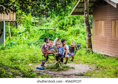 Kanjanaburi Province, Thailand-18 AUGUST 15: Disadvantaged Children playing playground where outback school in mountain wait for help  on 18 AUGUST 15, in Kanjanaburi Province, Thailand.
