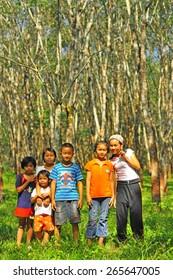 Kanjanaburi, THAILAND : a group of happy unidentified Thai children Playing on the playground with smile on faces. On October 24,2010 in Kanjanaburi ,Thailand.