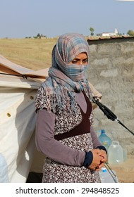 KANKE REFUGEE CAMP, DOHUK, KURDISTAN, IRAQ - 2015 JULY 4  - A Yazidi woman who escaped abuse from ISIS outside her tent in Kanke refugee camp