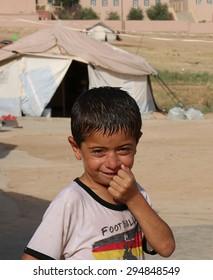 KANKE REFUGEE CAMP, DOHUK, KURDISTAN, IRAQ - 2015 JULY 4  - A young Yazidi boy posing for the camera inside Kanke refugee camp.