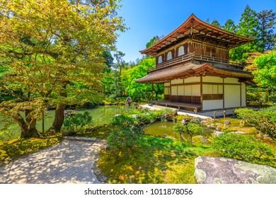 Kannon-Hall and pond in Ginkaku-ji Temple, spring season with blue sky. Ginkakuji or Silver Pavilion, officially named Jisho-ji, is a Zen temple in Higashiyama District, Kyoto, Japan.