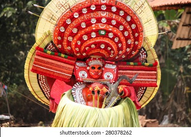 Kannur - 3/30/2015: A Theyyam artist performing during the festival at  Arathil Bhagavathi Temple on March 20, 2015 in Kannur,  Theyyam  is a ritualistic folk art form of North malabar in Kerala.