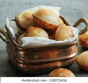 Kannur Appam - White Unniyappam in a Brass bowl, selective focus