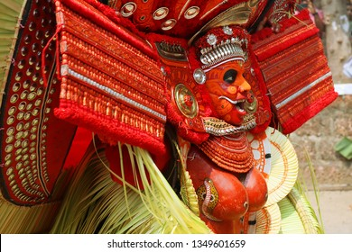 KANNUR - FEB 06: A Theyyam artist performs during the annual festival at Thidil Bhagavathi temple onFebruary 06, 2019 in Kannur, India.Theyyam is a ritualistic folk art form of Kerala -