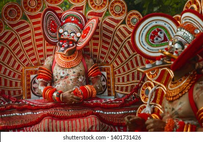 KANNUR, INDIA - DECEMBER 11, 2011: Theyyam performer in full costume, face mask, and makeup during a performance of Theyyam in a small village on December 11, 2011 near Kannur, Kerala, India.