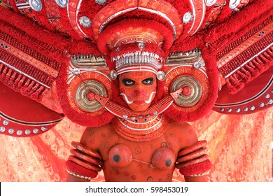 KANNUR - INDIA - FEBRUARY 2, 2017: Unidentified dancer at a traditional Theyyam ceremony in a temple on February 2, 2017 in Kannur, India. Theyyam is Kerala's most popular ritualistic art form.