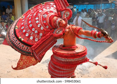 KANNUR - INDIA - FEBRUARY 2, 2017: Unidentified dancer at a traditional Theyyam ceremony in a temple on February 2, 2017 in Kannur, India. Theyyam is Kerala's most popular ritalistic art form.