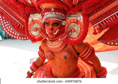 KANNUR - INDIA - FEBRUARY 5, 2017: Unidentified dancer at a traditional Theyyam ceremony in a temple on February 5, 2017 in Kannur, India. Theyyam is Kerala's most popular ritualistic art form.
