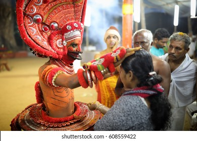 KANNUR - INDIA - FEBRUARY 8, 2017: Unidentified dancer at a traditional Theyyam ceremony in a temple on February 8, 2017 in Kannur, India. Theyyam is Kerala's most popular ritualistic art form.