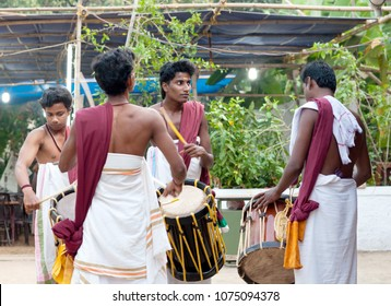 KANNUR, INDIA - JANUARY 15, 2016: Indian drummers playing Chenda drums during Theyyam ceremony