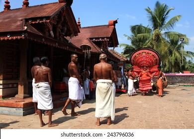 KANNUR - JAN 05: A Theyyam artist performs during the annual festival at Kadannappalli Muchilot Bhagavati temple on January 05, 2015 in Kannur, India.Theyyam is a ritualistic folk art form of Kerala