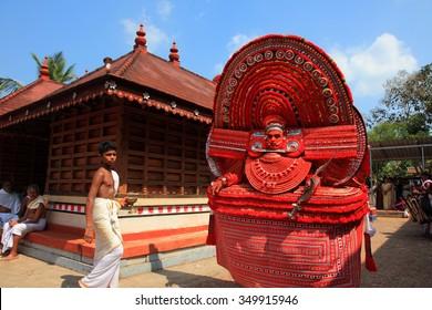KANNUR - JAN 05: An unidentified Theyyam artist performs at Kadannappalli Muchilot Bhagavati temple on January 05, 2015 in Kannur, India.Theyyam is a ritualistic traditional art form of Kerala