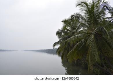 Kannur, Kerala, India: December 16, 2018 - Kavvayi backwaters view.