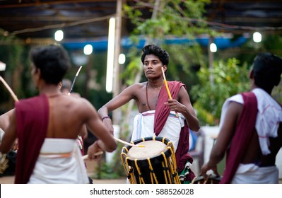 KANNUR, KERALA, INDIA - JANUARY 15, 2016: Indian drummers playing Chenda drums during Theyyam ceremony.